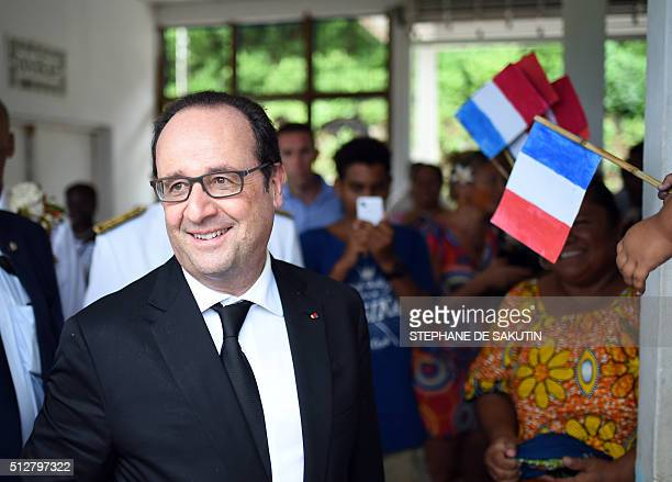 French President Francois Hollande leaves following a ceremony by 'la grande chefferie du royaume d'Alo' in Futuna island on February 22 in the...