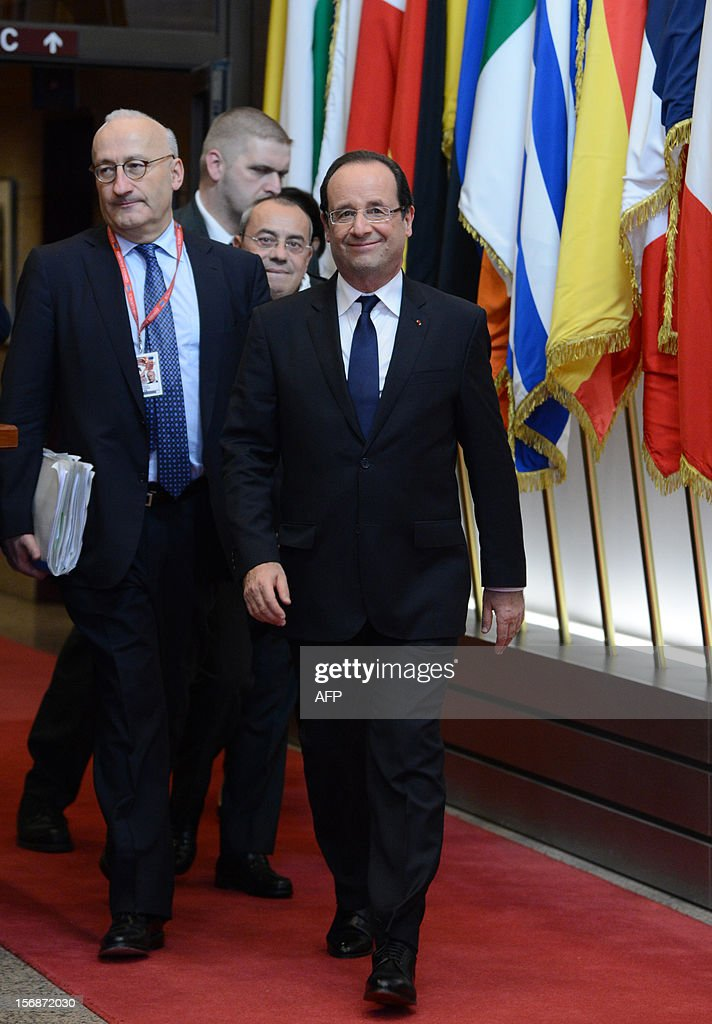 French President Francois Hollande leaves the EU Headquarters on November 23, 2012 in Brussels, during a two-day European Union leaders summit called to agree a hotly-contested trillion-euro budget through 2020. European Union officials were scrambling to find an all but impossible compromise on the 2014-2020 budget that could successfully move richer nations looking for cutbacks closer to poorer ones who look to Brussels to prop up hard-hit industries and regions. AFP PHOTO / THIERRY CHARLIER