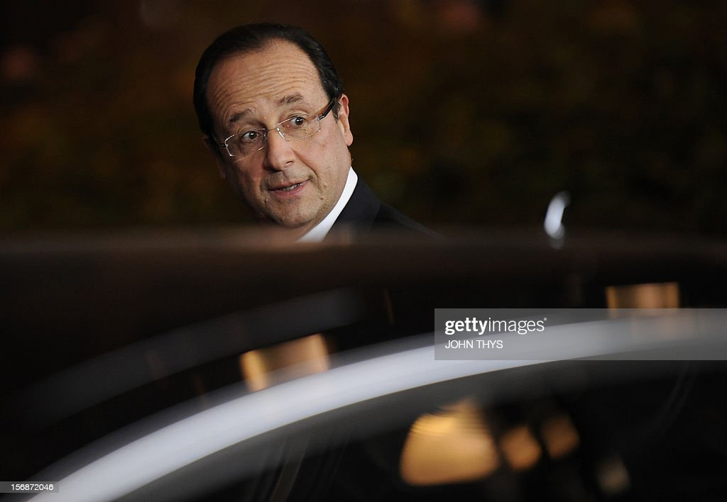 French President Francois Hollande leaves the EU Headquarters on November 23, 2012 in Brussels, during a two-day European Union leaders summit called to agree a hotly-contested trillion-euro budget through 2020. European Union officials were scrambling to find an all but impossible compromise on the 2014-2020 budget that could successfully move richer nations looking for cutbacks closer to poorer ones who look to Brussels to prop up hard-hit industries and regions. AFP PHOTO / JOHN THYS