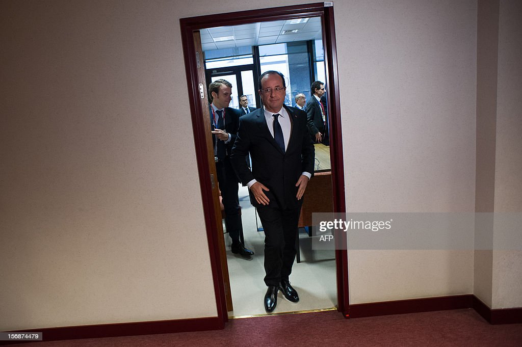 French President Francois Hollande leaves the France's office after a meeting at the EU Headquarters, on November 23, 2012 in Brussels, as part of a two-day European Union leaders summit called to agree a hotly-contested trillion-euro budget through 2020. European leaders voiced pessimism on reaching a deal on a trillion-euro EU bdget, as gruelling talks pushed into a second day with little prospect of bridging bitter divisions. POOL