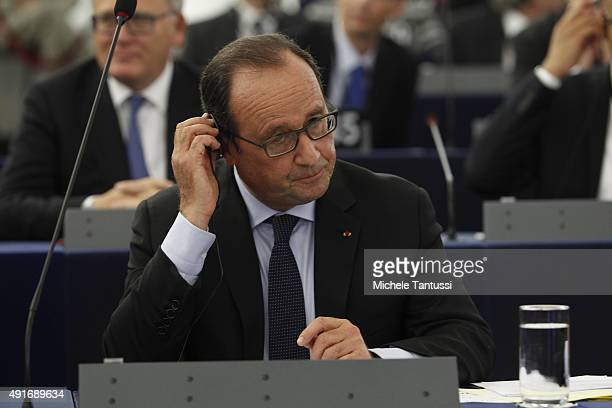 French president Francois Hollande listens during his joint speech with Germany's Chancellor to the members of the European Parliament in the plenary...