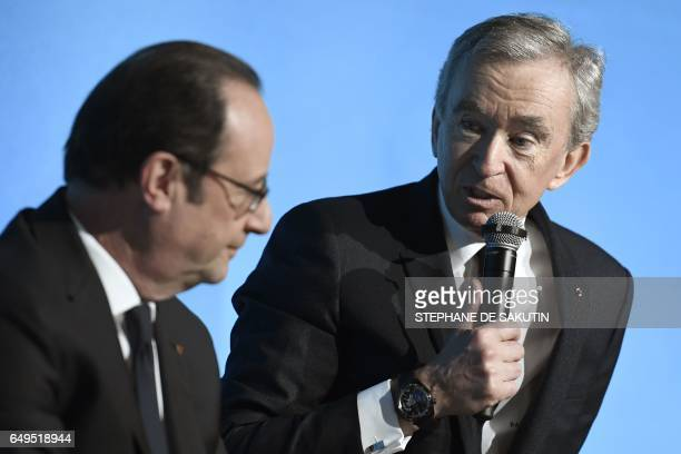 French president Francois Hollande listens to CEO of LVMH Bernard Arnault during a press conference to unveil a new museum in Paris on March 8 2017...