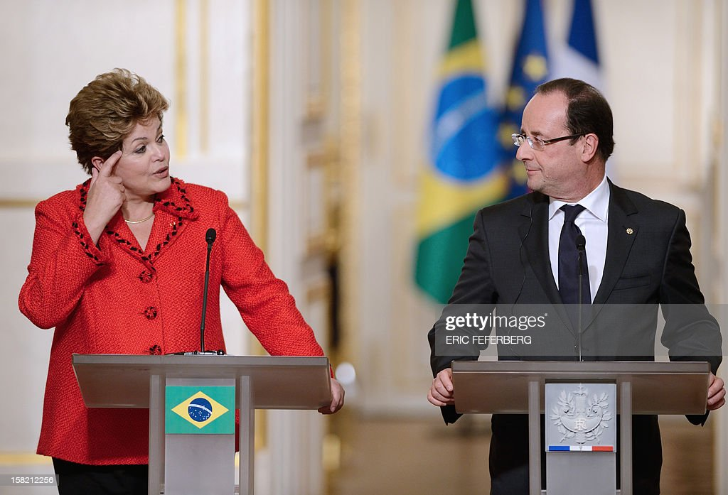 French President Francois Hollande (R) listens to his Brazilian counterpart Dilma Rousseff, on December 11, 2012, during a joint press conference at the Elysee presidential palace in Paris. Brazilian President Dilma Rousseff kicked off her first official visit to France, where a decision on whether she will choose Rafale fighter jets or opt for another aircraft is keenly awaited. During the two-day trip Rousseff will have talks with French counterpart Francois Hollande on the eurozone crisis -- on which she has criticized EU austerity measures -- bilateral trade and wider matters of global concern. AFP PHOTO / ERIC FEFERBERG