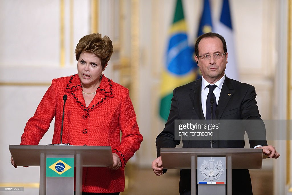 French President Francois Hollande (R) listens to his Brazilian counterpart Dilma Rousseff, on December 11, 2012, during a joint press conference at the Elysee presidential palace in Paris. Brazilian President Dilma Rousseff kicked off her first official visit to France, where a decision on whether she will choose Rafale fighter jets or opt for another aircraft is keenly awaited. During the two-day trip Rousseff will have talks with French counterpart Francois Hollande on the eurozone crisis -- on which she has criticized EU austerity measures -- bilateral trade and wider matters of global concern.