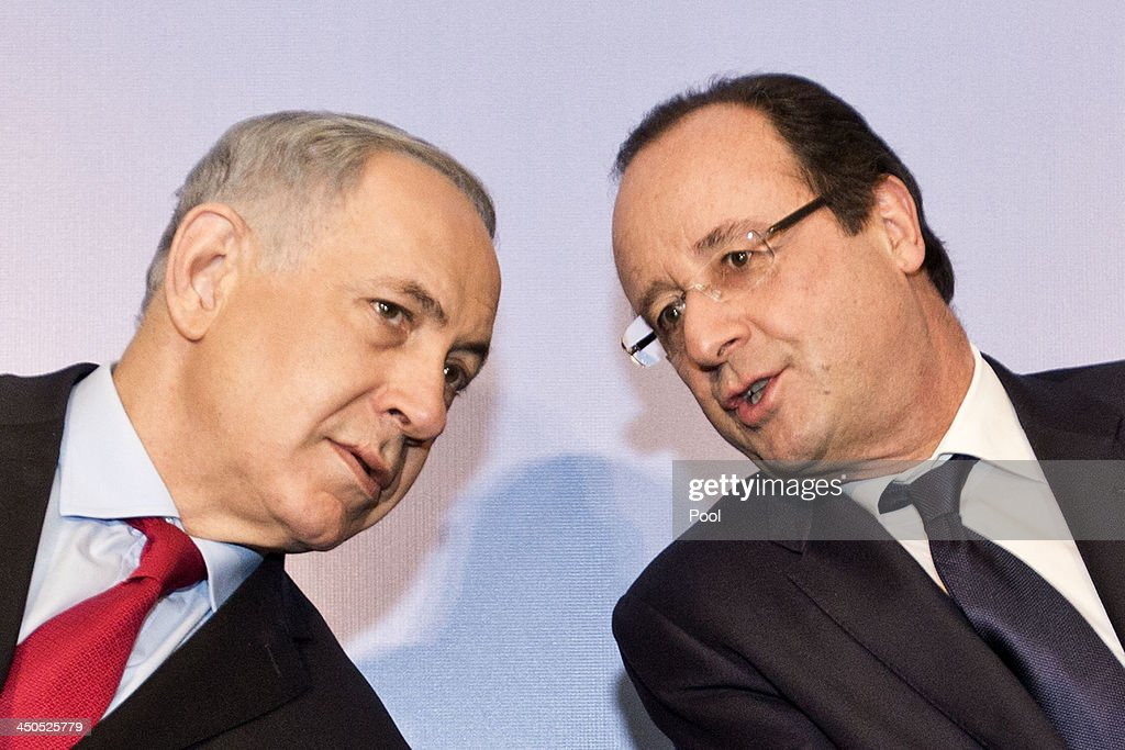 French President Francois Hollande listens to Israeli Prime Minister Benjamin Netanyahu during their visit to a FrenchIsraeli technology innovation...