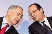 French President Francois Hollande listens to Israeli Prime Minister Benjamin Netanyahu during their visit to a FrenchIsraeli technology innovation...
