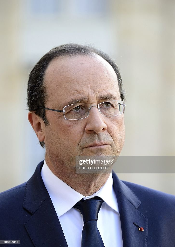 French President Francois Hollande listens to the Central African Republic President on April 1, 2014, after a working meeting at the Elysee presidential palace in Paris. The UN's refugee agency said today it was prepared to help evacuate some 19,000 Muslims at risk of attack from mainly Christian militias in the conflict-torn Central African Republic. Meanwhile the full line-up of France's new government is set to emerge after Hollande reacted to an electoral rout for his Socialist Party by naming popular Interior Minister Manuel Valls as prime minister.