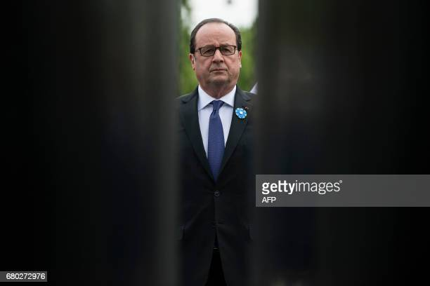 TOPSHOT French President Francois Hollande looks on after placing a wreath at the statue of French General and former President Charles de Gaulle...