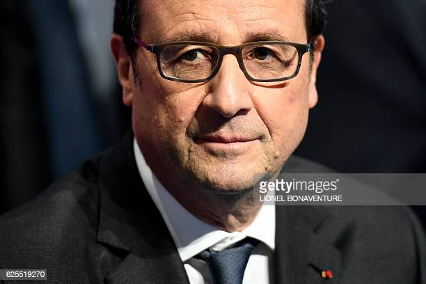 French president Francois Hollande looks on before delivering a speech on social contracts of employment at the end of the Conference on the social...