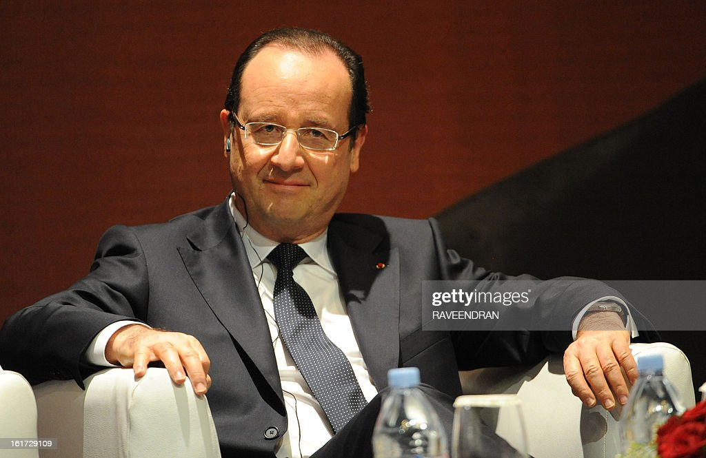 French President Francois Hollande looks on before giving a speech during a Madhavrao Scindia Foundation function in New Delhi on February 15, 2013. French President Francois Hollande in India for a two-day visit.