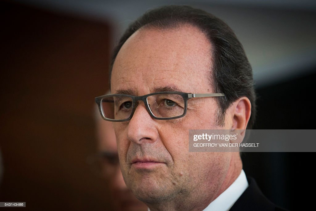 French President Francois Hollande looks on during the inauguration ceremony of the memorial of Dun-les-Places in tribute of the victims killed during the Second World War in Dun-les-Places on June 26, 2016. / AFP / GEOFFROY