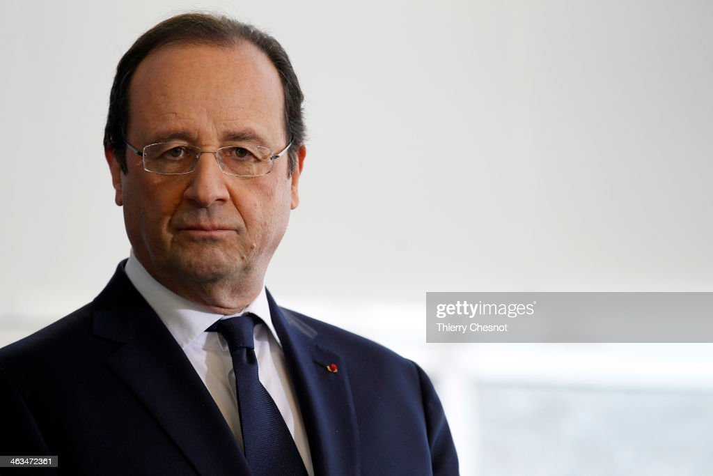French President Francois Hollande looks on during the opening of a fire and rescue department on January 18, in Tulle, France. Francois Hollande also visited the constituency of Correze, the department he headed before the presidential election, where he attended a New Year ceremony.