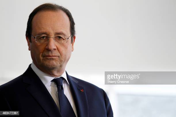 French President Francois Hollande looks on during the opening of a fire and rescue department on January 18 in Tulle France Francois Hollande also...