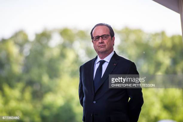French President Francois Hollande looks on prior to deliver a speech during a ceremony marking the 102nd anniversary of the Armenian genocide in...