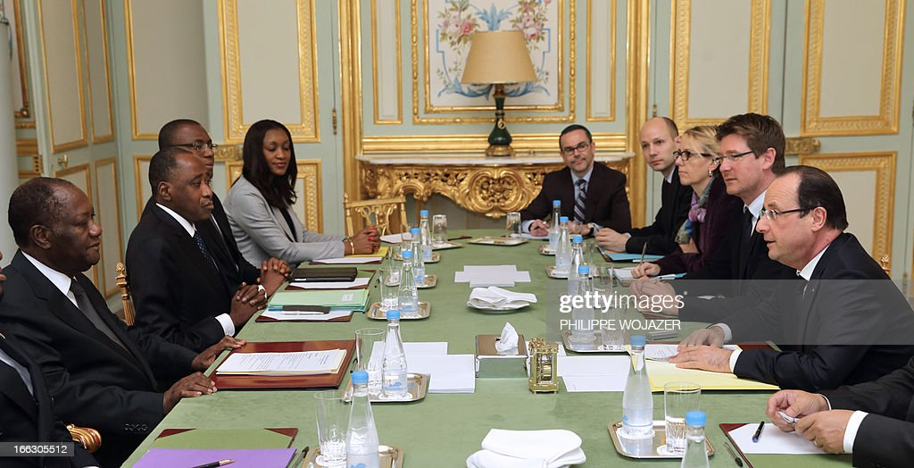 French President Francois Hollande (R) meets Ivory Coast's President Alassane Ouattara (L) at the Elysee Palace in Paris, April 11, 2013.