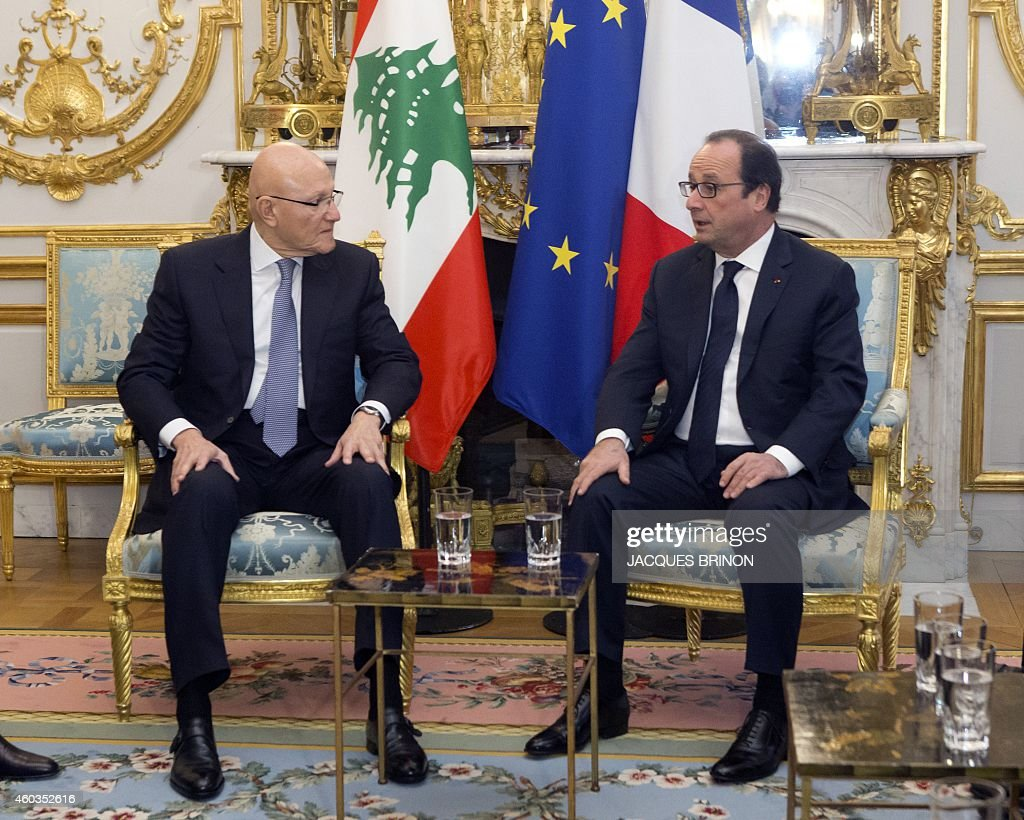 French President Francois Hollande (R) meets Lebanese Prime Minister <a gi-track='captionPersonalityLinkClicked' href=/galleries/search?phrase=Tammam+Salam&family=editorial&specificpeople=5769198 ng-click='$event.stopPropagation()'>Tammam Salam</a> at the Elysee Palace in Paris, on December 12, 2014. AFP PHOTO / POOL / JACQUEA BRINON