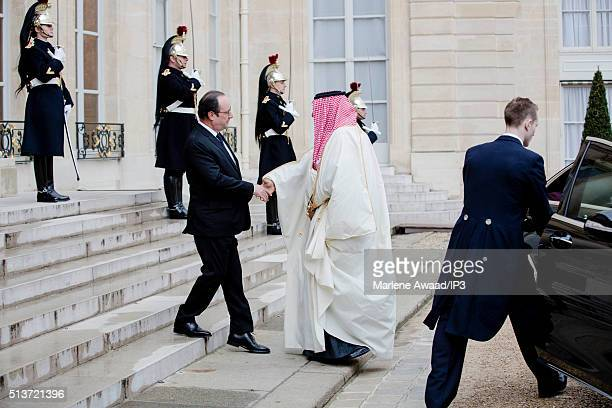 French President Francois Hollande meets Saudi Crown Prince Mohammed Bin Nayef as he arrives at Elysee Palace on March 4 2016 in Paris France