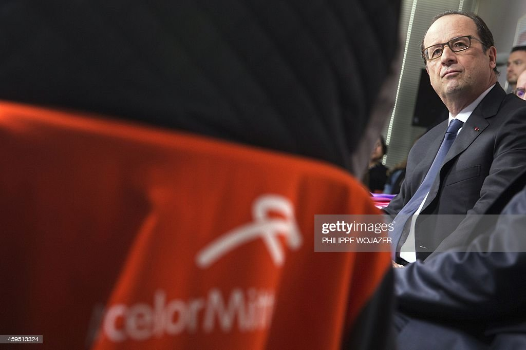 French President Francois Hollande meets with ArcelorMittal workers during a visit to the ArcelorMittal Steel Factory in Florange eastern France on...