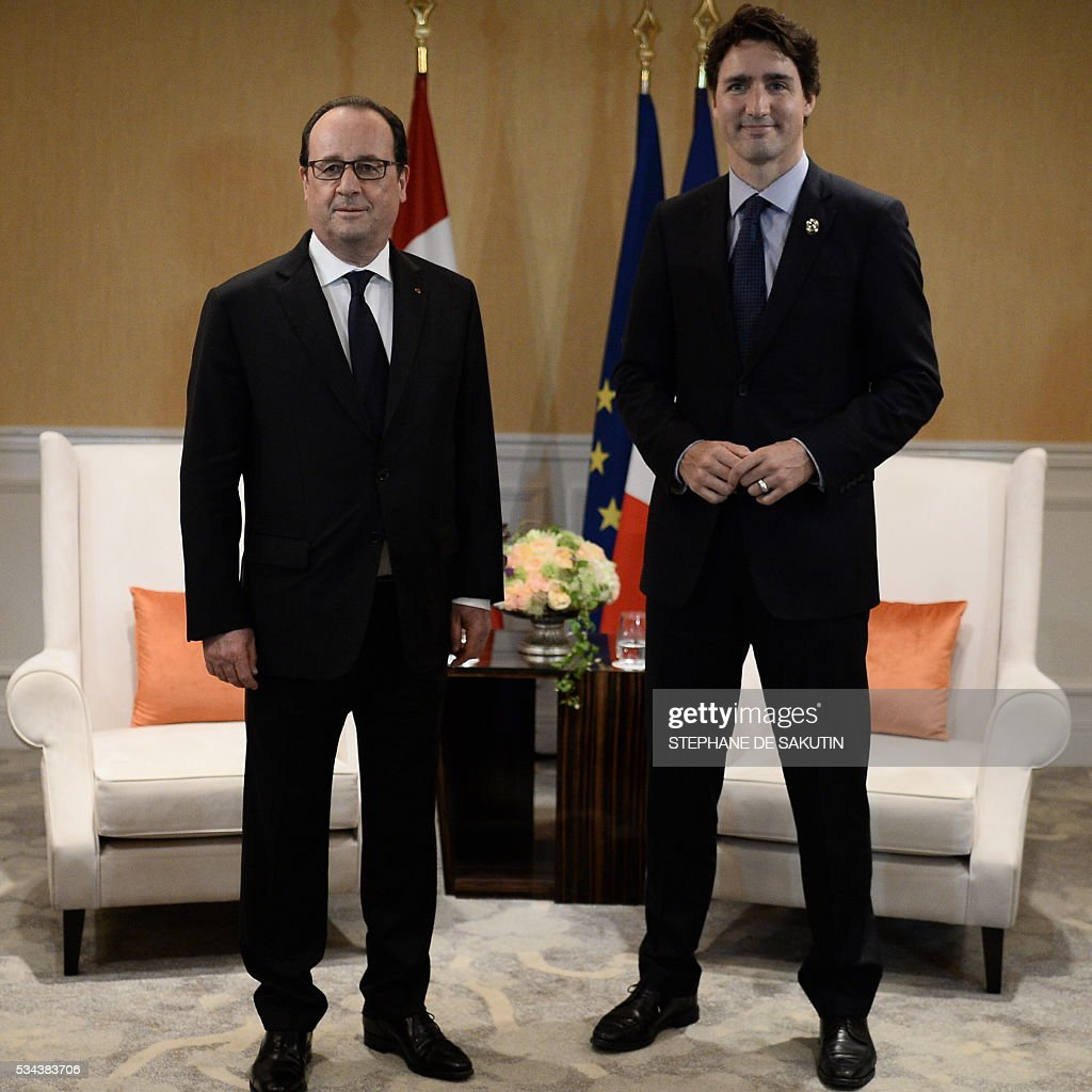 French President Francois Hollande (L) meets with Canadian Prime Minister Justin Trudeau for a bilateral meeting on the sidelines of the G7 Summit at Shima, Mie prefecture, on May 26, 2016. World leaders earlier kicked off two days of G7 talks in Japan on May 26 with the creaky global economy, terrorism, refugees, China's controversial maritime claims, and a possible Brexit headlining their packed agenda. / AFP / STEPHANE