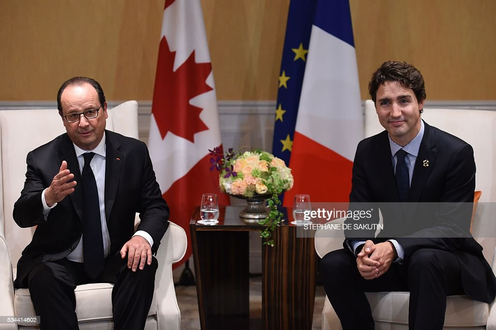 French President Francois Hollande (L) meets with Canadian Prime Minister Justin Trudeau for a bilateral meeting on the sidelines of the G7 Summit at Shima, Mie prefecture, on May 26, 2016. World leaders earlier kicked off two days of G7 talks in Japan on May 26 with the creaky global economy, terrorism, refugees, China's controversial maritime claims, and a possible Brexit headlining their packed agenda.