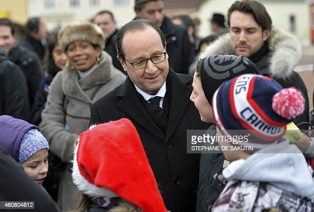 French President Francois Hollande meets with children at Miquelon on the French northern Atlantic island of SaintPierreetMiquelon which lies off the...