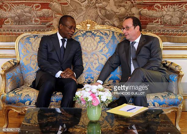 French President Francois Hollande meets with his Benin counterpart Patrice Talon on December 12 2016 at the Elysee palace in Paris / AFP / POOL /...