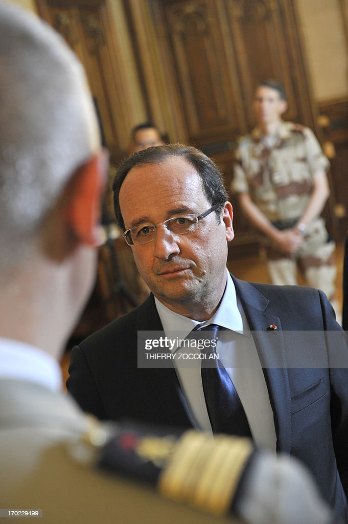 French President Francois Hollande meets with soldiers of the 126th regiment of the Brive-la-Gaillarde infantry, who participated in operation SERVAL in Mali, at the Prefecture in Tulle on June 9, 2013.