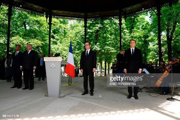 French President Francois Hollande newly elected president Emmanuel Macron and Senate president Gerard Larcher stand on May 10 2017 at the Jardins du...