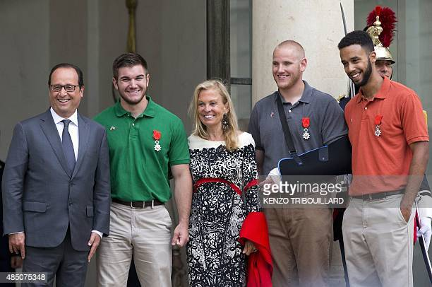 French President Francois Hollande offduty serviceman Alek Skarlatos US ambassador to France Jane Hartley offduty serviceman Spencer Stone and...
