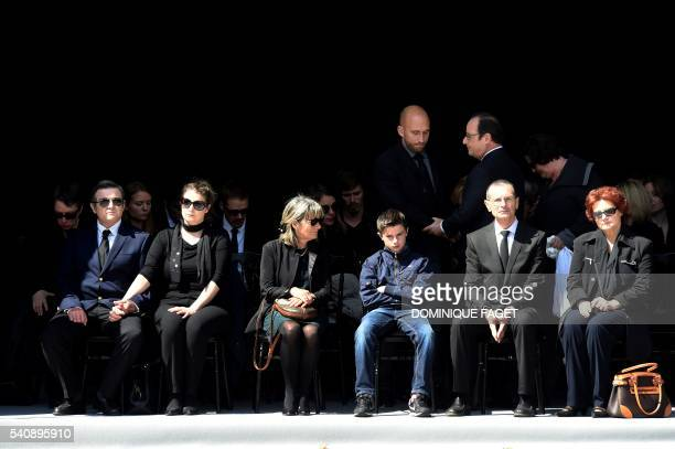 French President Francois Hollande pays his respect to the relatives of the police couple who were killed by an extremist pledging allegiance to the...