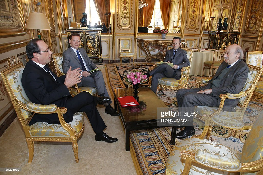 French President Francois Hollande, (L) political adviser for North Africa, Middle East and the United Nations Emmanuel Bonne, (2L), deputy spokesman at the French ministry of Foreign and European Affairs Romain Nadalattends (R) and Lebanese Druze leader Walid Joumblatt (R) meet at the Elysee Palace in Paris on January 28, 2013. AFP PHOTO / POOL / Francois Mori
