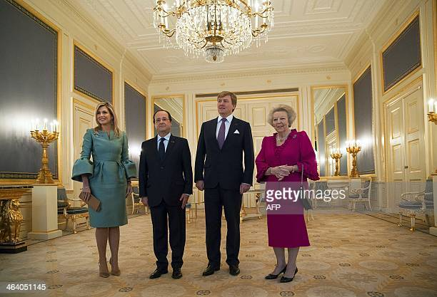 French President Francois Hollande poses for a photo with Dutch King WillemAlexander Queen Maxima and Princess Beatrix at royal palace Noordeinde in...