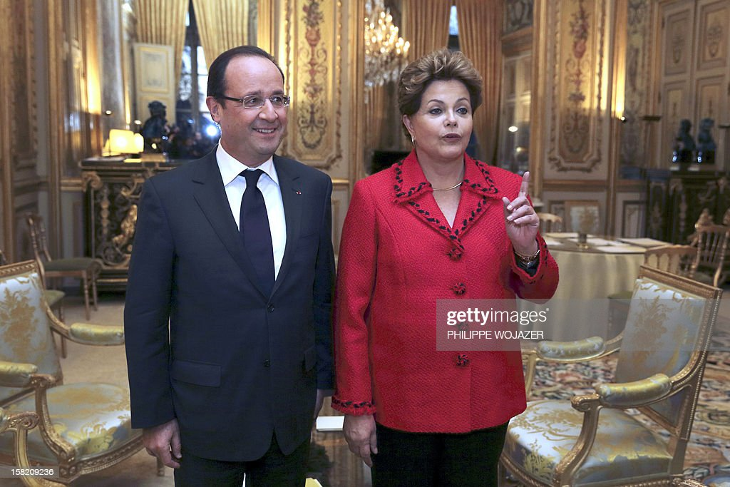 French president Francois Hollande (L) poses next to Brazil's president Dilma Rousseff prior to a meeting at the Elysee palace on December 11, 2012 in Paris, as part of Rousseff's two-day visit to France.