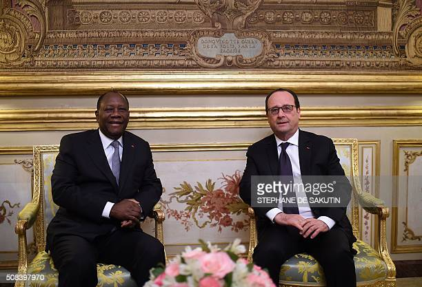 French President Francois Hollande poses next to Ivory Coast's President Alassane Ouattara prior to a meeting on February 4 2016 at the Elysee...