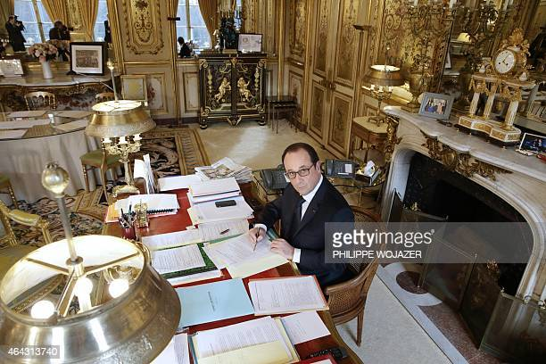 French President Francois Hollande poses on February 24 2015 at his desk in his office at the presidential Eysee palace in Paris AFP PHOTO / POOL /...