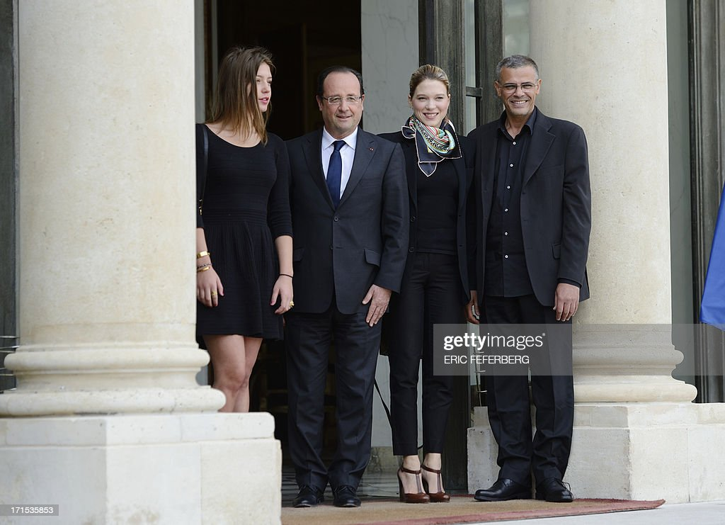 French President Francois Hollande (2ndL) poses on June 26, 2013 with the winners of the Palme d'Or, French actresses Adele Exarchopoulos (L) and Lea Seydoux (C) and French-Tunisian director Abdellatif Kechiche prior to a lunch at the Elysee Presidential palace in Paris.