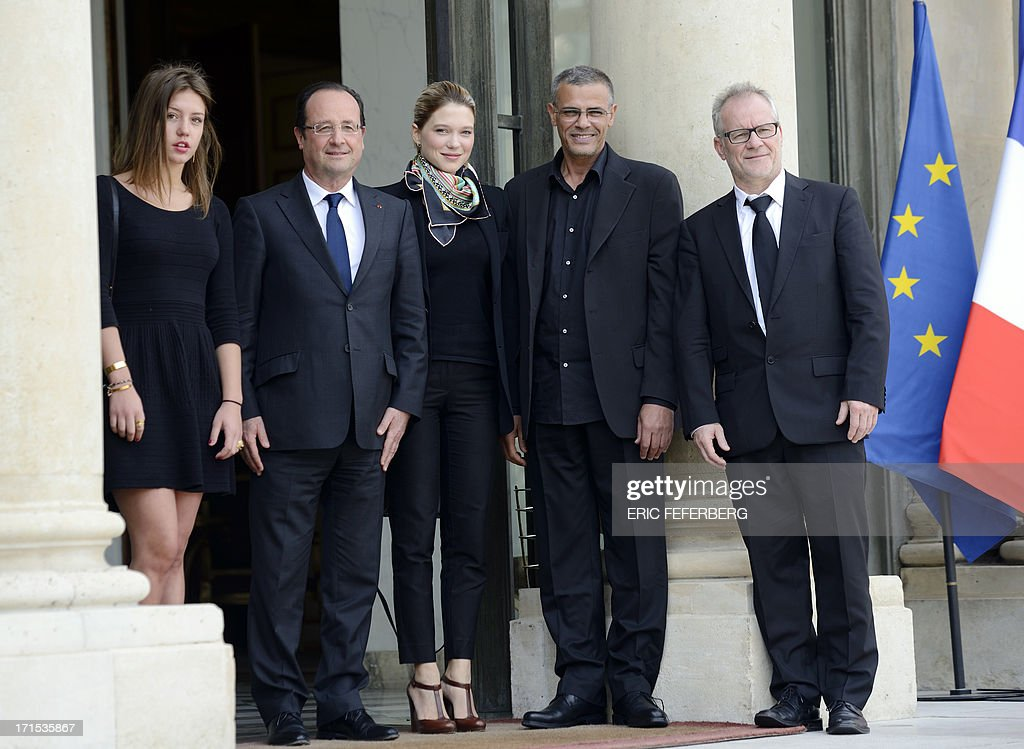 French President Francois Hollande (2ndL) poses on June 26, 2013 with the winners of the Palme d'Or, French actresses Adele Exarchopoulos (L) and Lea Seydoux (C) and French-Tunisian director Abdellatif Kechiche (2ndR) and the general delegate of the Cannes Film Festival Thierry Fremaux (R), prior to a lunch at the Elysee Presidential palace in Paris.