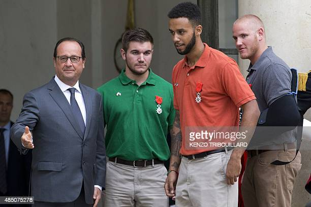 French President Francois Hollande poses together with to offduty serviceman Alek Skarlatos Anthony Sadler and offduty US serviceman Spencer Stone...