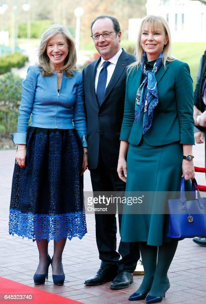 French President Francois Hollande poses with Disneyland Paris President Catherine Powell and European Commissioner for Internal Market Elzbieta...