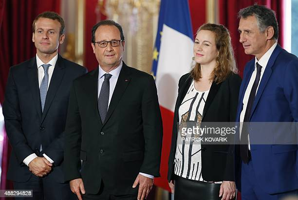 French president Francois Hollande poses with French Economy and Industry minister Emmanuel Macron French junior minister for Digital Economy Axelle...