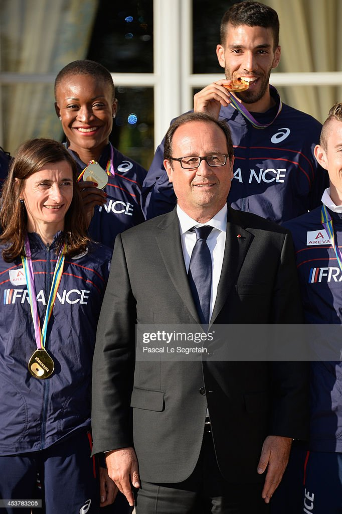 French President Francois Hollande (C) poses with French Gold medalists <a gi-track='captionPersonalityLinkClicked' href=/galleries/search?phrase=Christelle+Daunay&family=editorial&specificpeople=3111697 ng-click='$event.stopPropagation()'>Christelle Daunay</a> (L), Antoinette Nana Djimou (2nd Row L) and <a gi-track='captionPersonalityLinkClicked' href=/galleries/search?phrase=Mahiedine+Mekhissi-Benabbad&family=editorial&specificpeople=4472718 ng-click='$event.stopPropagation()'>Mahiedine Mekhissi-Benabbad</a> (R) at Elysee Palace on August 18, 2014 in Paris, France.