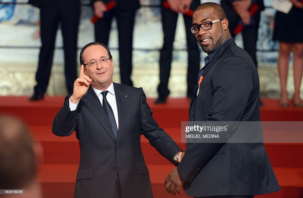 French President Francois Hollande (L) poses with French judoka Teddy Riner, gold medalist at the 2012 London olympics games, after his award with the French Legion d'Honneur during a ceremony on March 1, 2013 in Paris.