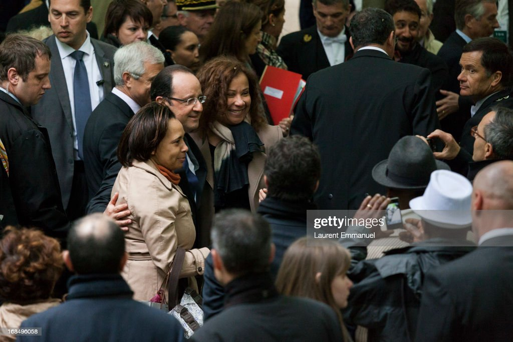 French President Francois Hollande (4th L) poses with guests as he attends a ceremony marking the abolition of slavery in the Jardins du Luxembourg on May 10, 2013 in Paris, France. Taubira Law was passed in May 2001 acknowledging slavery and the Atlantic slave trade as crimes against humanity.