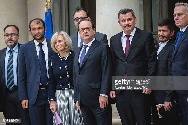 French President Francois Hollande poses with Rahed Al Saleh President of 'Casques blancs' a group of volunteer medical operating in rebel areas in...
