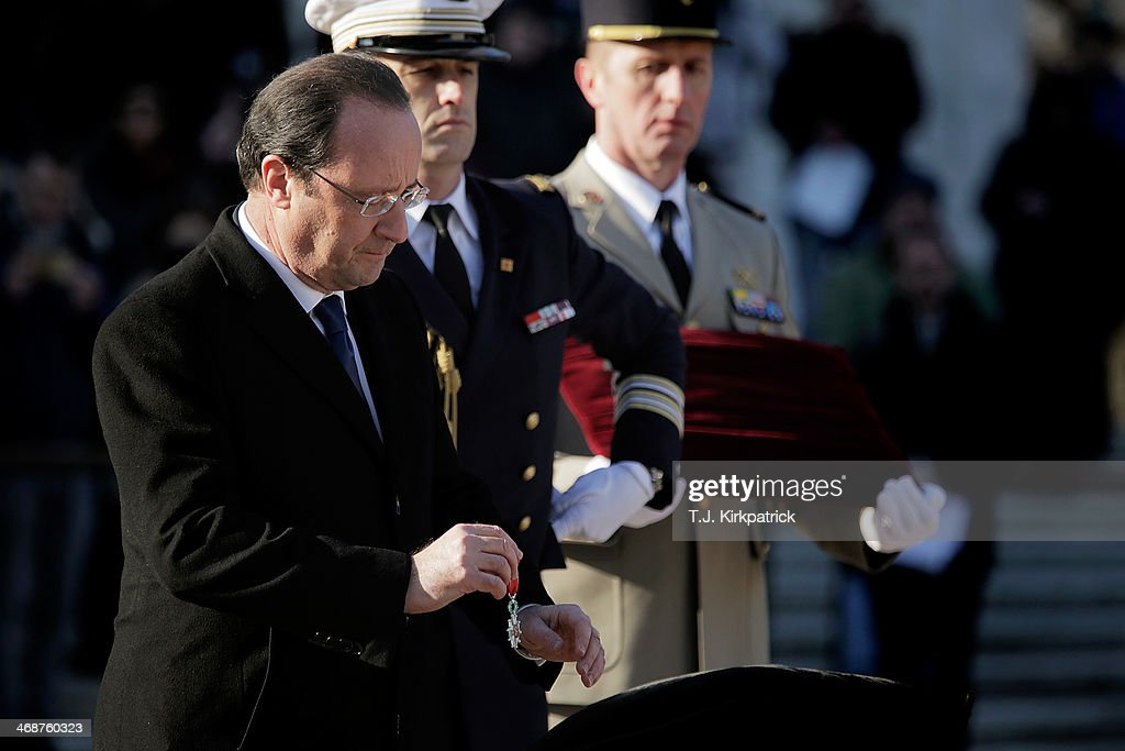 French President Francois Hollande presents the Legion of Honor Medal to the World War II Unknown on February 11, 2014 in Arlington, Virginia. 2014 marks the 70th anniversary of the Allied Forces D-Day landing in Normandy, which helped lead to the liberation of France and the European continent.