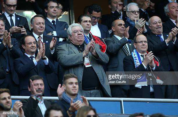French President Francois Hollande president of French Rugby League Paul Goze and Prince Albert of Monaco attend the Top 14 Final between RC Toulon...