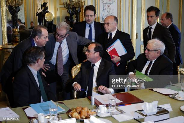French President Francois Hollande President's Chief of Staff JeanPierre Jouyet Interior Minister Matthias Fekl Prime Minister Bernard Cazeneuve head...