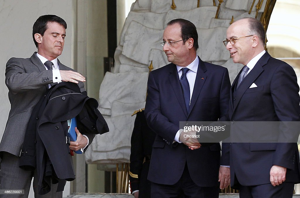 French President, Francois Hollande, Prime minister, <a gi-track='captionPersonalityLinkClicked' href=/galleries/search?phrase=Manuel+Valls&family=editorial&specificpeople=2178864 ng-click='$event.stopPropagation()'>Manuel Valls</a> and <a gi-track='captionPersonalityLinkClicked' href=/galleries/search?phrase=Bernard+Cazeneuve&family=editorial&specificpeople=4205153 ng-click='$event.stopPropagation()'>Bernard Cazeneuve</a>, Minister of the Interior leave after a cabinet meeting at the Elysee Palace on April 23, 2014 in Paris, France. It is the fourth weekly cabinet meeting of France's newly appointed government of Prime Minister <a gi-track='captionPersonalityLinkClicked' href=/galleries/search?phrase=Manuel+Valls&family=editorial&specificpeople=2178864 ng-click='$event.stopPropagation()'>Manuel Valls</a>.