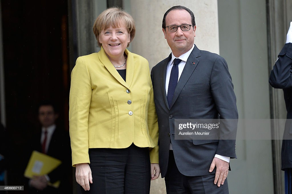 French President Francois Hollande (R) receives German Chancellor <a gi-track='captionPersonalityLinkClicked' href=/galleries/search?phrase=Angela+Merkel&family=editorial&specificpeople=202161 ng-click='$event.stopPropagation()'>Angela Merkel</a> at the Elysee Palace on February 20, 2015 in Paris, France. They will discuss the current situation in the Ukraine and ongoing situations concerning the European Union.