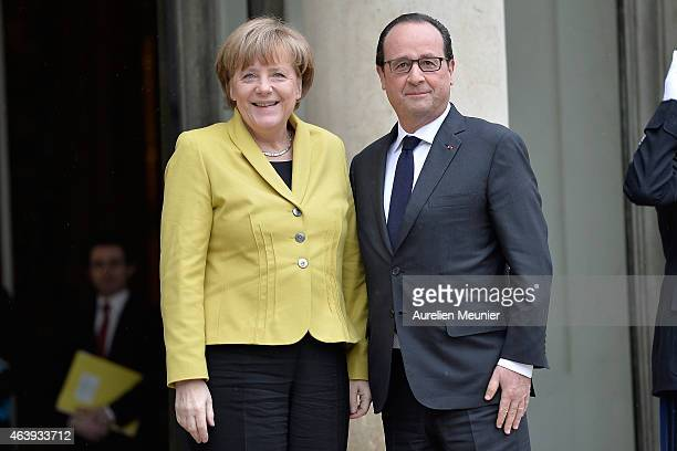 French President Francois Hollande receives German Chancellor Angela Merkel at the Elysee Palace on February 20 2015 in Paris France They will...
